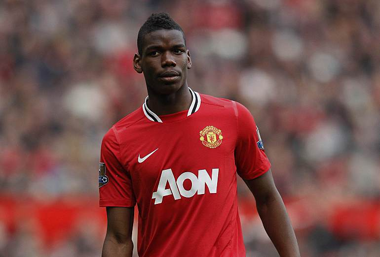 "Manchester United's Paul Pogba walks across the pitch during their English Premier League soccer match against West Bromwich Albion at Old Trafford in Manchester, March 11, 2012. REUTERS/Phil Noble (BRITAIN - Tags: SPORT SOCCER) FOR EDITORIAL USE ONLY. NOT FOR SALE FOR MARKETING OR ADVERTISING CAMPAIGNS. NO USE WITH UNAUTHORIZED AUDIO, VIDEO, DATA, FIXTURE LISTS, CLUB/LEAGUE LOGOS OR ""LIVE"" SERVICES. ONLINE IN-MATCH USE LIMITED TO 45 IMAGES, NO VIDEO EMULATION. NO USE IN BETTING, GAMES OR SINGLE CLUB/LEAGUE/PLAYER PUBLICATIONS"