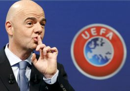 UEFA General Secretary Gianni Infantino asks the audience for silence before the draw for the play-off matches for UEFA Euro 2016 at the UEFA headquarters in Nyon, Switzerland, October 18, 2015. The draw will define the four pairings as well as the order of the home-and-away ties. The first legs will be played between 12 and 14 November and the return legs between 15 and 17 November in line with the Week of Football match pattern. REUTERS/Denis Balibouse      TPX IMAGES OF THE DAY