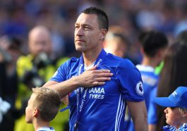 LONDON, ENGLAND - MAY 21: John Terry of Chelsea pats the Chelsea badge on his shirt after the Premier League match between Chelsea and Sunderland at Stamford Bridge on May 21, 2017 in London, England.  (Photo by Clive Rose/Getty Images)
