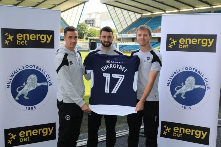 Millwall midfielder Shaun Williams, and defenders Conor McLaughlin and Tony Craig unveil the new 2017-18 season Millwall home shirt at The Den. Finished in striking navy blue with white applications, and featuring 'EnergyBet' emblazoned on the back, the new kit is a powerful symbol of the strong Millwall-EnergyBet partnership that will help propel the club to success this season.  The away kit is white with blue applications and logos. (PRNewsfoto/energybet)