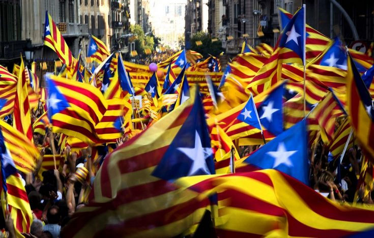 SEPTEMBER 11: Demonstrators wave Catalan flags during a protest rally in Barcelona, Spain. Thousands of people joined a rally demanding independence for Catalonia, in northeastern Spain, on the Catalan national day. (Emilio Morenatti/Associated Press)